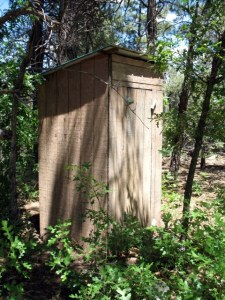The outhouse still stands, even though there's a flushable toilet inside