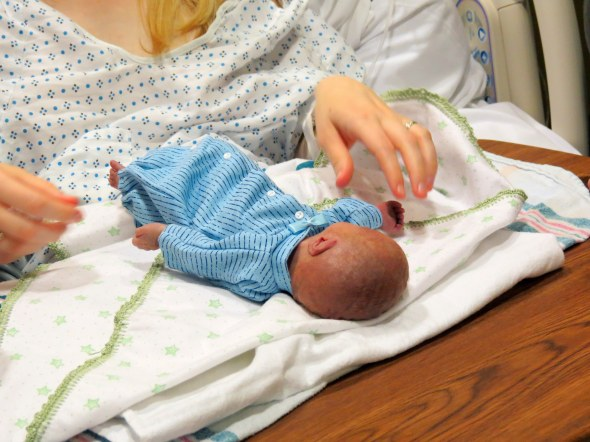 Christian was born at 25 weeks and weighed 1 lb 13.5 oz. He was 12.5 inches long. Tiny!